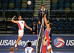 Dominican Republic's Capellan Lopez hits against Puerto Rico blocker Juan Ruiz during the Pan American Cup at the Reno Events Center in Reno, Nev., on Monday, Aug. 17, 2015. <br /> Photo by Cathleen Allison