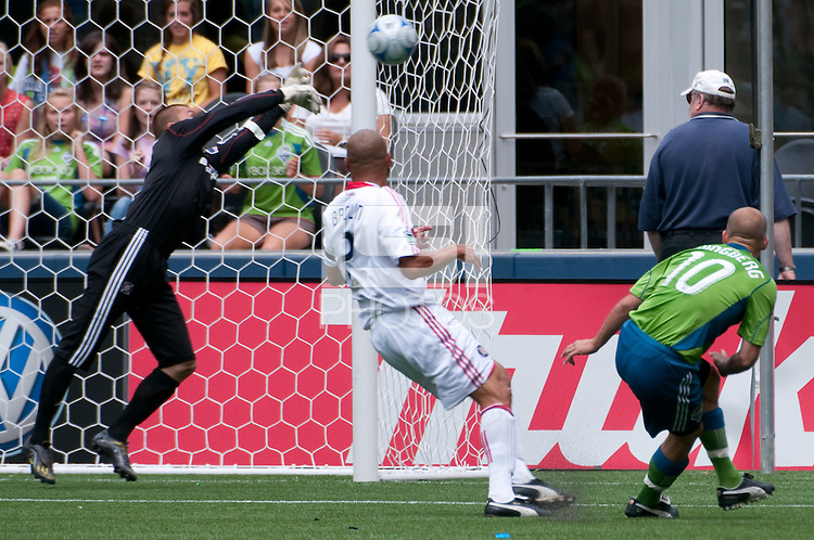 Fredy Ljungberg(10) of the Seattle Sounders shoots against Jon Busch (l) and C.J. Brown (c) of the Chicago Fire in the match at the XBox Pitch at Quest Field on July 25, 2009. The Sounders and Fire played to a 0-0 draw.