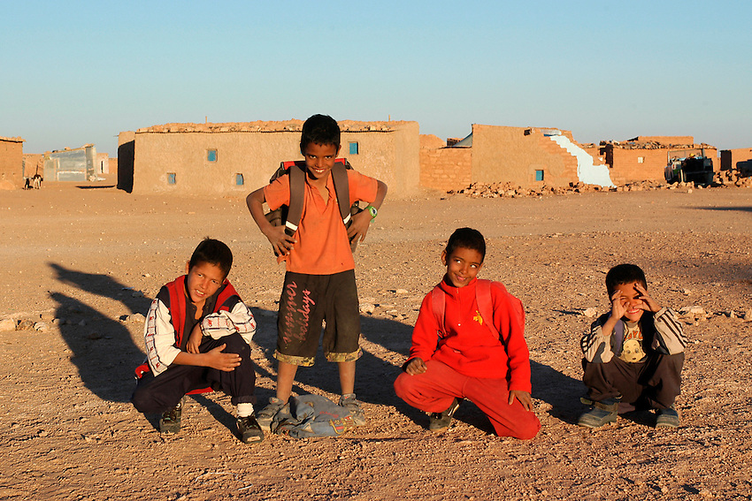 Children play in Aaiun wilaya on December 14, 2003. Saharawi people have been living at the refugee camps of the Algerian desert named Hamada, or desert of the deserts, for more than 30 years now. Saharawi people have suffered the consecuences of European colonialism and the war against occupation by Moroccan forces. Polisario and Moroccan Army are in conflict since 1975 when Hassan II, Moroccan King in 1975, sent more than 250.000 civilians and soldiers to colonize the Western Sahara when Spain left the country. Since 1991 they are in a peace process without any outcome so far. (Ander Gillenea / Bostok Photo)