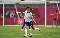 KASHIMA, JAPAN - AUGUST 2: Alex Morgan #13 of the United States kicks the ball during a game between Canada and USWNT at Kashima Soccer Stadium on August 2, 2021 in Kashima, Japan.