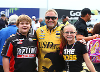 Jul. 28, 2013; Sonoma, CA, USA: NHRA funny car driver Jeff Arend with daughter Jenna Arend during the Sonoma Nationals at Sonoma Raceway. Mandatory Credit: Mark J. Rebilas-