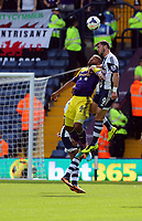 Pictured L-R: Mid air battle for a header against Ashley Williams of Swansea and Shane Long of West Brom. Sunday 01 September 2013<br /> Re: Barclay's Premier League, West Bromwich Albion v Swansea City FC at The Hawthorns, Birmingham, UK.
