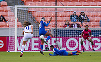 HOUSTON, TX - JANUARY 31: Raquel Rodriguez #11 of Costa Rica shoots the ball into Kethna Louis #20 of Haiti during a game between Haiti and Costa Rica at BBVA Stadium on January 31, 2020 in Houston, Texas.