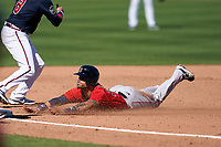 Boston Red Sox Michael Chavis (23) slides head first into third base during a Major League Spring Training game against the Atlanta Braves on March 7, 2021 at CoolToday Park in North Port, Florida.  (Mike Janes/Four Seam Images)