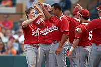 Florida Southern Moccasins Sam Machonis (32) high fives teammates after hitting a home run during an exhibition game against the Detroit Tigers on February 29, 2016 at Joker Marchant Stadium in Lakeland, Florida.  Detroit defeated Florida Southern 7-2.  (Mike Janes/Four Seam Images)