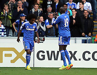 Sunday, 13 April 2014<br /> Pictured: Demba Ba of Chelsea (R) celebrating his goal, making the final score 1-0 to his team. <br /> Re: Barclay's Premier League, Swansea City FC v Chelsea at the Liberty Stadium, south Wales,