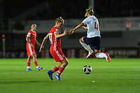 Jess Fishlock of Wales Women vies for possession with Jordan Nobbs of England Women during the FIFA Women's World Cup Qualifier match between Wales and England at Rodney Parade on August 31, 2018 in Newport, Wales.