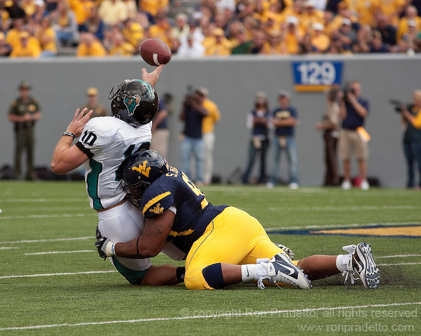 September 4, 2010: West Virginia defensive lineman Scooter Berry hits Coastal Carolina quarterback Zach MacDowall. The West Virginia Mountaineers defeated the Coastal Carolina Chanticleers 31-0 on September 4, 2010 at Mountaineer Field, Morgantown, West Virginia.