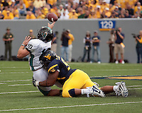 September 4, 2010: West Virginia defensive lineman Scooter Berry hits Coastal Carolina quarterback Zach MacDowall. The West Virginia Mountaineers defeated the Coastal Carolina Chanticleers 31-0 on September 4, 2010 at Mountaineer Field, Morgantown, West Virginia.