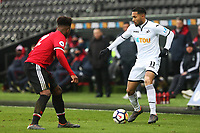 Sunday 18 March 2018<br /> Pictured:  Ethan Laird of Manchester United marks Kenji Gorre of Swansea City<br /> Re: Swansea City v Manchester United U23s in the Premier League 2 at The Liberty Stadium on March 18, 2018 in Swansea, Wales.