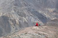 Monk in morning meditation. On the old road  ('Jalebi Mod') near Lamayuru Village<br /> Ladakh<br /> Jammu and Kashmir<br /> India