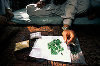 A miner negotiating the sale of 2 month of heavy work at 4000 meters high of dozen of Moudjahidins in the emeralds valley, Panshir Afghanistan