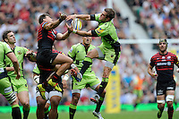 Schalk Brits of Saracens and Stephen Myler of Northampton Saints compete in the air during the Aviva Premiership Final between Saracens and Northampton Saints at Twickenham Stadium on Saturday 31st May 2014 (Photo by Rob Munro)