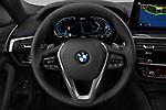 Car pictures of steering wheel view of a 2021 BMW 5-Series 530e-Sport 4 Door Sedan Steering Wheel