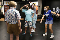 """Summer Programs Manager Alexa Bella (third from left) prompts Kate Rockwood (from left), Gabrielle Mason and Amelia Adams to perform tableaus, an acting method creating frozen pictures on stage, Monday, July 19, 2021 at Trike Theater in Bentonville. Local high schoolers participated in a two week, self-devised camp in preparation for a senior performance of Tiger In My Suit. The students use different acting strategies to create stories and unpack emotions through theater, said Alexa Bella, the summer programs manager. """"We're just excited to be back from last year being fully virtual,"""" she said. """"It's a little hard getting everyone out of their shells on Zoom. It's their first summer hosting camps in their new building. Check out nwaonline.com/210720Daily/ for today's photo gallery. <br /> (NWA Democrat-Gazette/Charlie Kaijo)"""