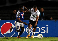 BOGOTA - COLOMBIA, 27-11-2020: Elvis Perlaza de Millonarios F. C. y Alejandro Garcia de Once Caldas disputan el balon, durante partido entre Millonarios F. C. y Once Caldas de la fecha 1 por la Liguilla BetPlay DIMAYOR 2020 jugado en el estadio Nemesio Camacho El Campin de la ciudad de Bogota. / Elvis Perlaza of Millonarios F. C. and Alejandro Garcia of Once Caldas figth for the ball, during a match between Millonarios F. C. and Once Caldas of the 1st date for the BetPlay DIMAYOR 2020 Liguilla played at the Nemesio Camacho El Campin Stadium in Bogota city. / Photo: VizzorImage / Luis Ramirez / Staff.