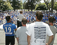 San Jose Earthquakes player look on as general manager Alexi Lalas speaks to a crowd of approximately 1,500 Earthquakes fan gathered at the Soccer Silicon Valley Rally held in downtown San Jose, CA on August 20, 2004 to show support for the club.  The non-profit Soccer Silicon Valley group hope to find a local buyer or soccer specific stadium for the Earthquakes within the next month so the team is not relocated to San Antonio or Houston, TX by its current investor/operator Anschutz Entertainment Group.