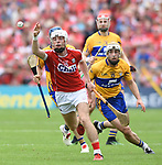 Luke Meade of Cork in action against Conor Mc Grath of Clare during their Munster senior hurling final at Thurles. Photograph by John Kelly.
