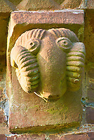 Norman Romanesque exterior corbel no 16 - sculpture of a rams head that symbolise the Apostles of the church. Apostles are like rams because they have strong foreheads which toss = evil out of the way. .  The Norman Romanesque Church of St Mary and St David, Kilpeck Herefordshire, England. Built around 1140