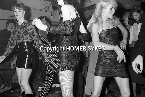 Blitz Kids New Romantics at The Blitz Club Covent Garden, London, England 1980.<br /> <br /> Girl on left is Lorraine from the dance troupe Spoonoch. Girl in middle is Wendy May who was Billy Idol's girlfriend in the band Chelsea. Plus Wendy TigerPearson Wendy Tiger Pearson (on right)