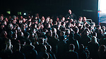 """© Joel Goodman - 07973 332324 . 03/11/2017 . Manchester , UK . TOMMY ROBINSON (real name Stephen Yaxley-Lennon ) speaks to supporters at the launch of the former EDL leader's book """" Mohammed's Koran """" at Castlefield Bowl . Originally planned as a ticket-only event at Bowlers Exhibition Centre , the launch was moved at short notice to a public location in the city . Photo credit : Joel Goodman"""