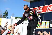 Feb 8, 2015; Pomona, CA, USA; NHRA top fuel driver J.R. Todd during the Winternationals at Auto Club Raceway at Pomona. Mandatory Credit: Mark J. Rebilas-