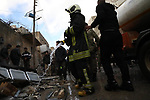 Rescue workers extinguish a fire cause by an explosion in the town of Azaz in the rebel-controlled northern countryside of Syria's Aleppo province,on January 31, 2021. A car bomb killed at least six people, including three civilians, in the Turkish-held northern town of Azaz in war-torn Syria today, a war monitor said. The attack, which occurred near a cultural centre, also wounded more than 22 others, the Britain-based Syrian Observatory for Human Rights said. Photo by Nayef ALaboud