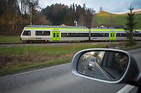 Switzerland. Canton  Luzern. Hüswil. View from the side window of a VW Touran on cars. BLS AG is a Swiss railway company created by the 2006 merger of BLS Lötschbergbahn and Regionalverkehr Mittelland AG. It is 55.8% owned by the canton of Berne, and 21.7% by the Swiss Confederation. It has two main business fields: passenger traffic and infrastructure. BLS has a subsidiary BLS Cargo which is responsible for all freight operations.  7.12.2020 © 2020 Didier Ruef