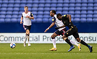 Bolton Wanderers' Nathan Delfouneso breaks away from Oldham Athletic's Brice Ntambwe (left) <br /> <br /> Photographer Andrew Kearns/CameraSport<br /> <br /> The EFL Sky Bet League Two - Bolton Wanderers v Oldham Athletic - Saturday 17th October 2020 - University of Bolton Stadium - Bolton<br /> <br /> World Copyright © 2020 CameraSport. All rights reserved. 43 Linden Ave. Countesthorpe. Leicester. England. LE8 5PG - Tel: +44 (0) 116 277 4147 - admin@camerasport.com - www.camerasport.com