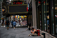 NEW YORK, NY - AUGUST 8: Homeless rest in Times Square on August 8, 2020 in New York City. With more than four months NYC has closed some of their doors to combat the coronavirus, putting its vital tourism industry paralyzed with a moribund economy, where business and leaders are trying to revive an industry that brought in $45 billion annually and supported more than 300,000 jobs. (Photo by Eduardo MunozAlvarez/VIEWpress)