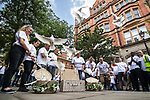 © Joel Goodman - 07973 332324 . 26/06/2017 . Manchester , UK . 22 doves are released at a short ceremony in St Ann's Square . Fire-fighters wearing symbolic Manchester bee t-shirts walk from Manchester Central Fire Station to St Ann's Square in Manchester City Centre for a short ceremony and release of 22 doves , in commemoration of the 22 people killed in a murderous terrorist attack , carried out by Salman Abedi , following an Arina Grande concert at the Manchester Arena , on 22nd May 2017 . Local fire crews have expressed frustration after they were held back from attending to support other emergency services for nearly two hours after the bombing , on the night of the attack . Photo credit : Joel Goodman