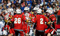 Grant Catalino (1) of Maryland celebrates his goal with teammates during the Face-Off Classic in at M&T Stadium in Baltimore, MD