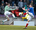 Tom Walsh wins the ball ahead of the flying Paul McMullan