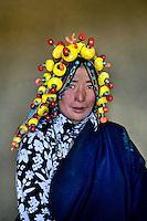 Kham, Tibet 2005.<br /> Woman wearing amber, Kham, Eastern Tibet, 2006