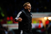 Saturday 2nd Febuaray 2014<br /> Pictured: Garry Monk, Manager of Swansea City celebrates after Nathan Dyer scores his second half goal<br /> Re: Barclays Premier League Swansea City FC  v Cardiff City FC at the Liberty Stadium, Swansea