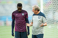 England manager Roy Hodgson talks to Danny Welbeck during training