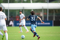 LAKE BUENA VISTA, FL - JULY 23: Russell Teibert #31 of Vancouver Whitecaps FC dribbles the ball during a game between Chicago Fire and Vancouver Whitecaps at Wide World of Sports on July 23, 2020 in Lake Buena Vista, Florida.