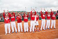 16-09-12, Netherlands, Amsterdam, Tennis, Daviscup Netherlands-Suisse, Winning Suisse team celebrating on court
