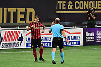 ATLANTA, GA - AUGUST 22: Franco Escobar #2 and Ted Unkel discuss a call during a game between Nashville SC and Atlanta United FC at Mercedes-Benz Stadium on August 22, 2020 in Atlanta, Georgia.