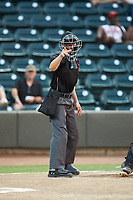 Home plate umpire Steven Jaschinski makes a strike call during the Carolina League game between the Lynchburg Hillcats and the Winston-Salem Dash at BB&T Ballpark on August 1, 2019 in Winston-Salem, North Carolina. The Dash defeated the Hillcats 9-7. (Brian Westerholt/Four Seam Images)