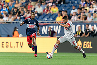 FOXBOROUGH, MA - JULY 7: Alejandron Pozuelo #10 of Toronto FC dribbles at midfield during a game between Toronto FC and New England Revolution at Gillette Stadium on July 7, 2021 in Foxborough, Massachusetts.