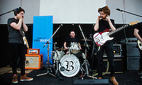 08 APR 2016 - STOWMARKET, GBR - Callum Ferguson and James Betts of The Baskervilles cover their ears as  the bands drummer Blair Ferguson going through his sound check before the recording for BBC Introducing at the John Peel Centre for Creative Arts in Stowmarket, Suffolk, Great Britain (PHOTO COPYRIGHT © 2016 NIGEL FARROW, ALL RIGHTS RESERVED)