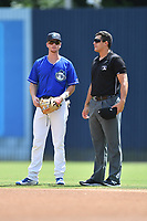 Asheville Tourists second baseman Taylor Snyder (28) talks with first base umpire Anthony Warner during a game against the Rome Braves at McCormick Field on September 3, 2018 in Asheville, North Carolina. The Tourists defeated the Braves 5-4. (Tony Farlow/Four Seam Images)