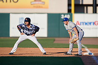 Dunedin Blue Jays first baseman Kacy Clemens (21) holds his brother Kody Clemens (8) on during a Florida State League game against the Lakeland Flying Tigers on May 18, 2019 at Publix Field at Joker Marchant Stadium in Lakeland, Florida.  Dunedin defeated Lakeland 3-2 in eleven innings.  (Mike Janes/Four Seam Images)