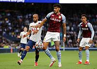 3rd October 2021; Tottenham Hotspur Stadium. Tottenham, London, England; Premier League football, Tottenham versus Aston Villa: Tyrone Mings of Aston Villa challenged by Lucas Moura of Tottenham Hotspur