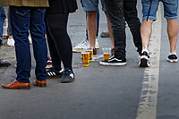 Pictured: Lager in plastic containers rest on the floor in Mumbles. Friday 16 April 2021<br /> Re: People enjoy an evening out after Covid-19 lockdown rules were relaxed, in Swansea Bay, Wales, UK.