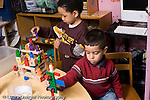 Education Preschool 3-4 year olds two boys playing separately building and construction toys horizontal