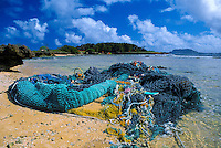 Discarded fishing nets entangle in coral or wash up on beaches and harm Hawaii's fragile marine environment.