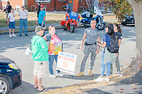 People gather with protest signs as alt-right organization Super Happy Fun America prepares to demonstrate against facemasks, vaccines, and pandemic closures, and in support of the reelection of President Donald J. Trump near the residence of Massachusetts governor Charlie Baker in Swampscott, Massachusetts, on Sat., Sept. 26, 2020. Super Happy Fun America is most well known for organizing the Straight Pride Parade in Boston on August 31, 2019.