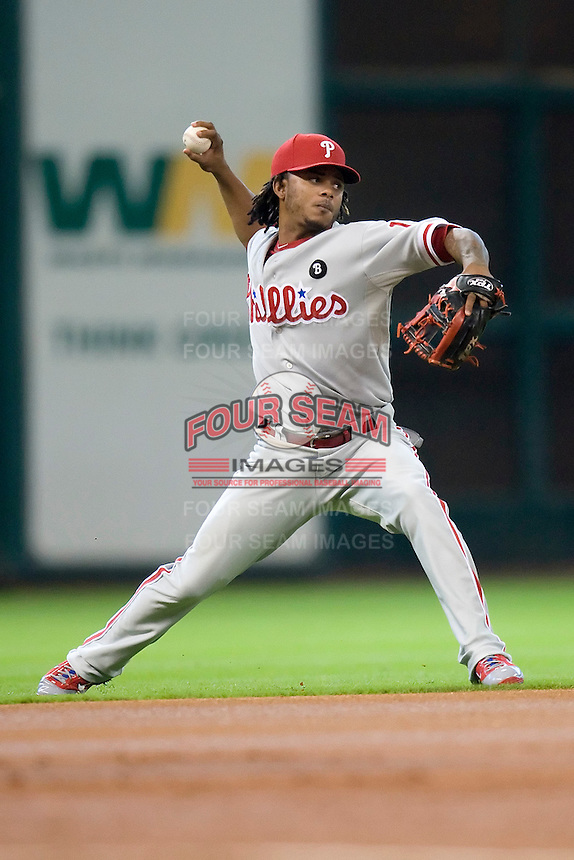Philadelphia Phillies shortstop Michael Martinez #19 throws the ball to first base during the Major League Baseball game against the Houston Astros at Minute Maid Park in Houston, Texas on September 14, 2011. Philadelphia defeated Houston 1-0 to clinch a playoff berth.  (Andrew Woolley/Four Seam Images)
